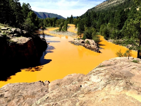 Jerry McBride/Durango Herald08/06/15-Durango - Mine waste from the Gold King Mine north of Silverton fills the Animas River at Bakers Bridge on Thursday morning.